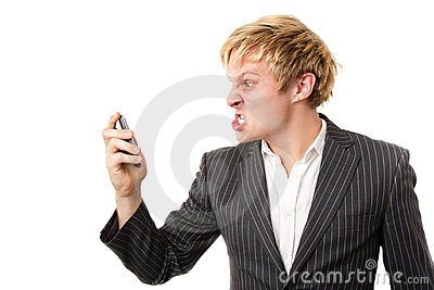 Angry young man shouting on the phone