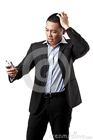 Angry young man shouting using mobile