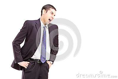 Angry young man in a suit shouting