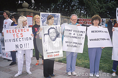 Animal rights demonstrators holding signs, Editorial Photo