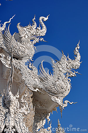 Animal sculptures on roof at wat rong khun