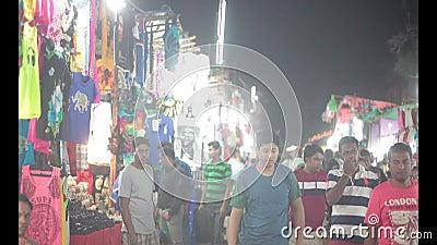 Anjuna night market. Tourists in traditional Anjuna night market. Goa, India stock video footage