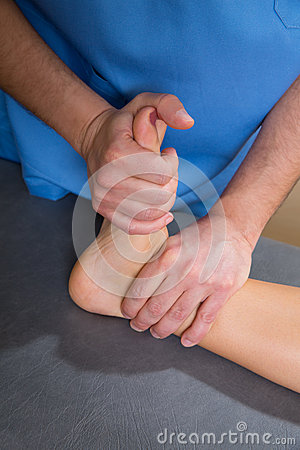 Ankle physiotherapy treatment with therapist hands