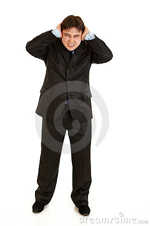 Annoyed businessman  closing ears with hands