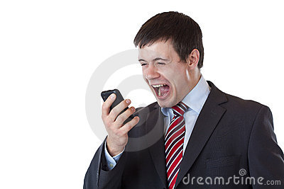 Annoyed young businessman screaming in telephone