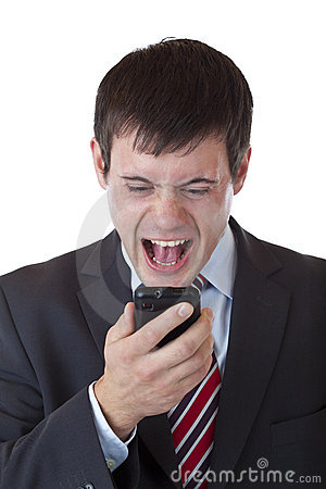 Annoyed young manager shouts aloud in cell phone