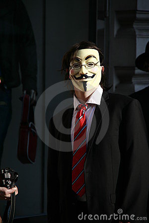 Anonymous activist with Guy Fawkes mask Editorial Stock Image