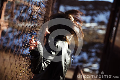 Anonymous woman portrait over fence