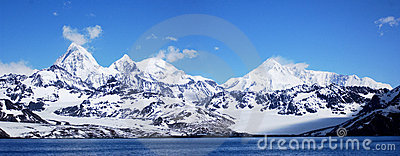 Antarctic mountain in a blue sky