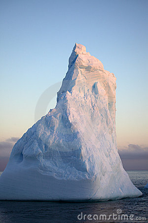 Antarctica blue iceberg in sunset