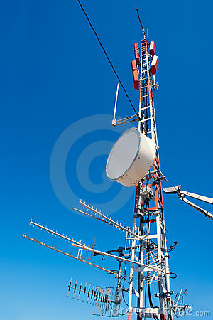 Antenna repeater messy mast in blue sky