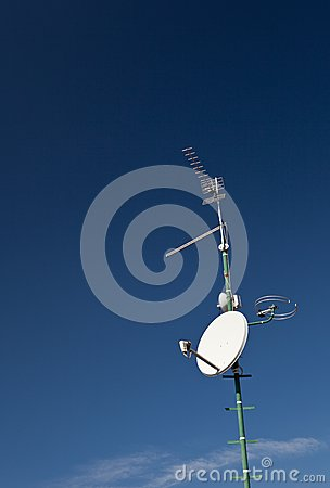 Antennas and a satellite dish on a roof