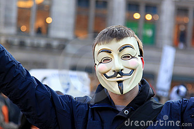 Anti-ACTA protest with Anonymous mask in Amsterdam Editorial Stock Photo
