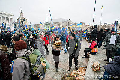 Anti-government demonstrators harvest woodfire occupying main Maidan square and require to sign the documents of Accession to EU Editorial Image