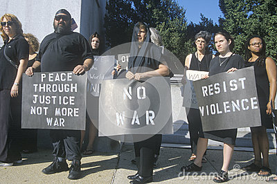Anti-war protester in black marching at rally Editorial Image