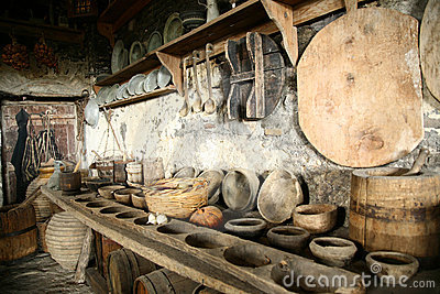 Antiquarian tableware in old kitchen.