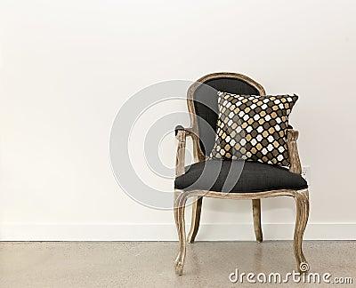 Antique armchair near wall