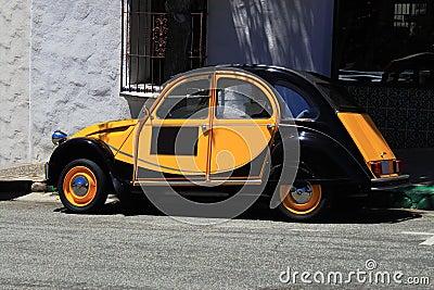 Antique Black Orange Beatle Car