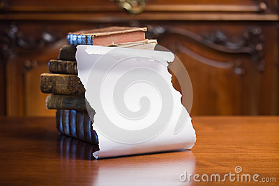 Antique books with empty scroll.