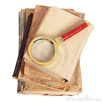 Antique books, gold magnifying