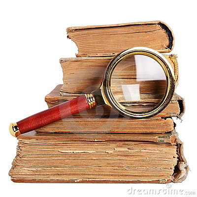 Antique books and magnifying glass