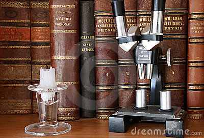 Antique books and microscope