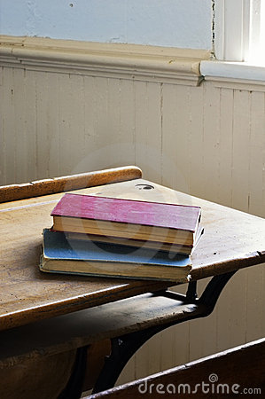 Antique Books Stacked on School Desk Dramatic Light