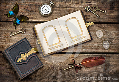 Antique books, writing accessories and butterfly Stock Photo