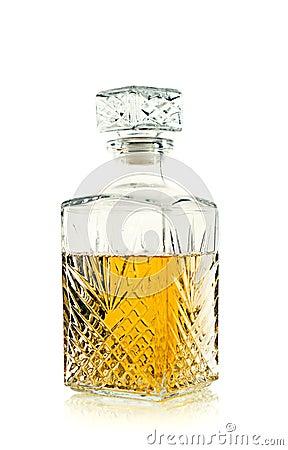 Antique bottle of whiskey / Scotch on white