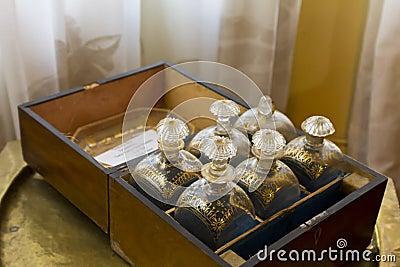 Antique brandy bottles in wooden box