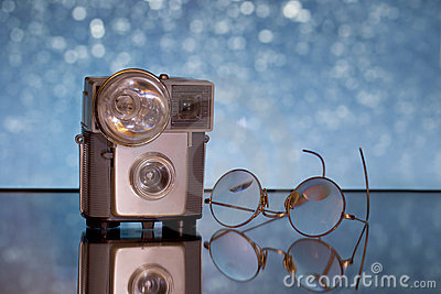 Antique camera and glasses