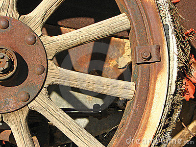 Antique car front wheel with busted tire