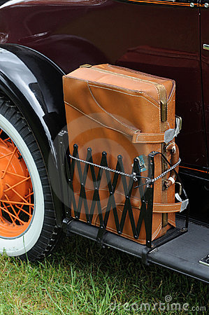 Antique car with a leather suitcase