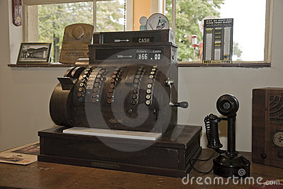 Antique Cash Register and Telephone