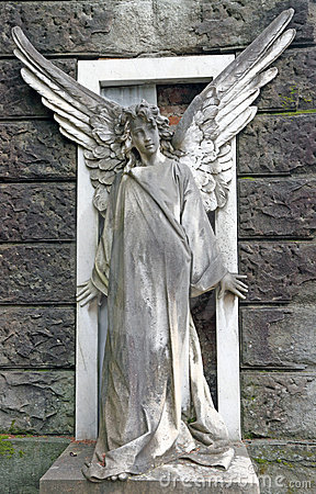 Antique cemetery angel on monumental cemetery