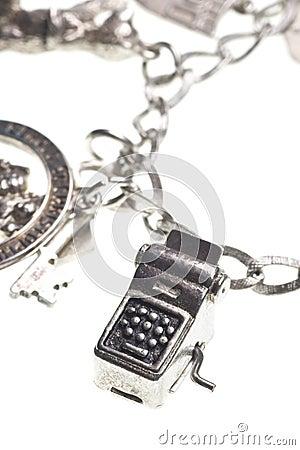 Antique charm bracelet with typewriter