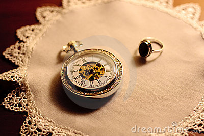 Antique clock and golden ring