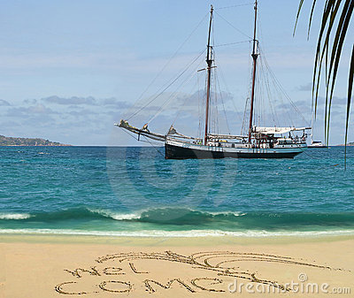 Antique cruise boat & welcome on tropical beach.