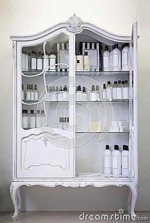 Antique cupboard, open door, medical bottles