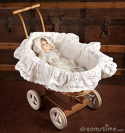 Antique doll in cradle