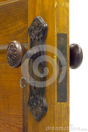 Antique door and door handle with skeleton key in