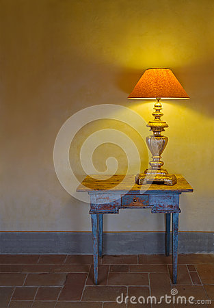 Antique interior with a lamp on a table