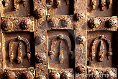 Antique iron door decorated with horseshoes