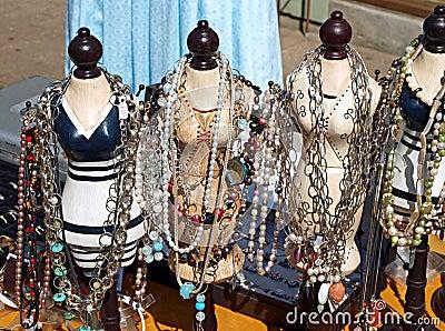 Antique jewelery items on figurines
