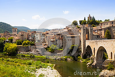 Antique medieval town with old gate on bridge