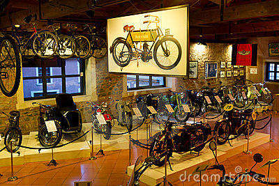 Antique motorcycles and vintage bicycles Editorial Stock Image