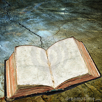 Antique open book on cracked surface