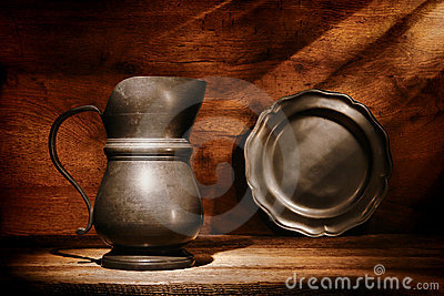 Antique Pewter Pitcher and Plate on Old Wood Shelf