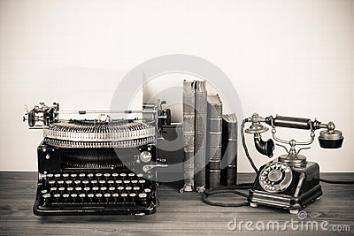 Antique phone and typewriter