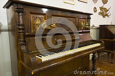 Antique piano with detailed carving